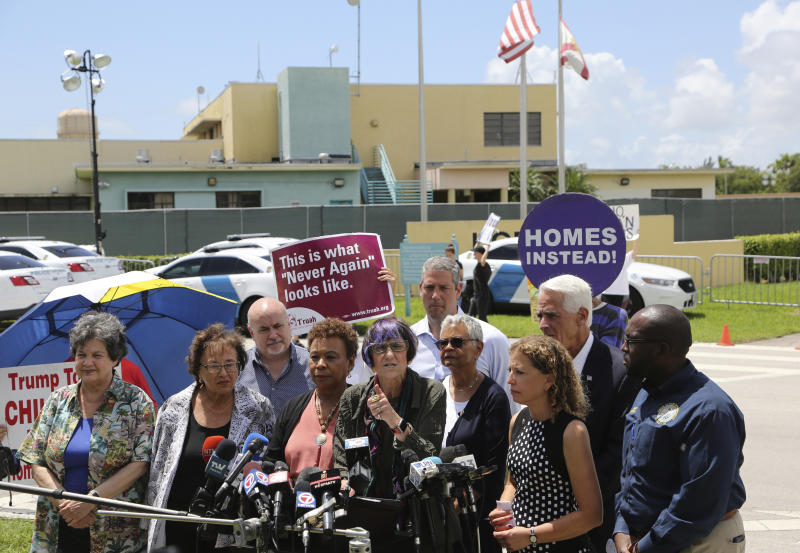 Rep. Rosa DeLauro, D-Conn., center, stands with other members of Congress following a tour of the Homestead Shelter for Unaccompanied Children, Monday, July 15, 2019, in Homestead, Fla. (AP Photo/Lynne Sladky)