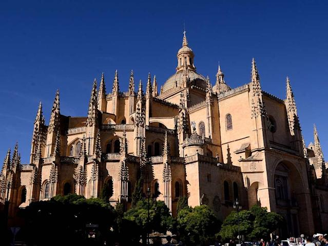 Segovia Cathedral, Spain I chanced upon the Segovia Cathedral after a sumptuous dinner at Plaza Mayor. Dedicated to Virgin Mary, the cathedral stood glowing in gold, lit under the night sky. We came back to visit it the following day and learnt that the original cathedral was built next to the Fortress, the Alcazar, but was reduced to ruins in a war. Built in Gothic style in the 16th century, the church is one of the key landmarks of the city, apart from the fortress.