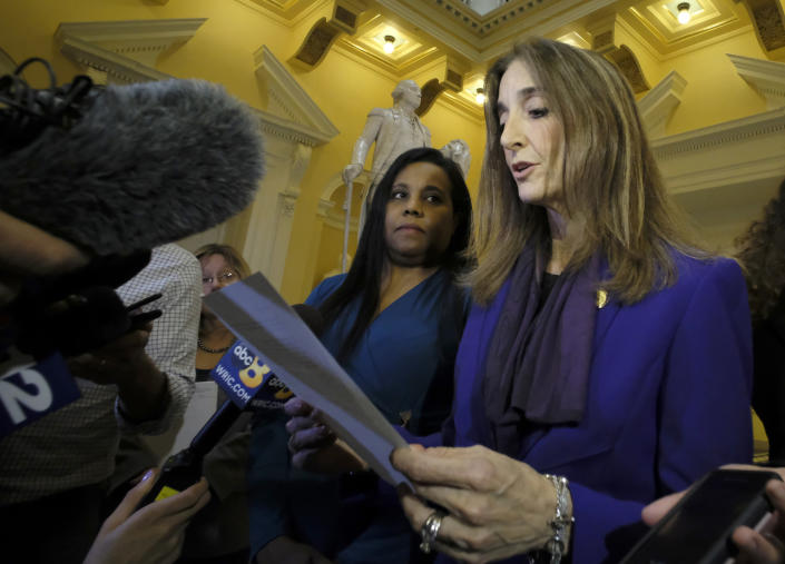 FILE - In this Feb. 21, 2019 file photo, Del. Charniele Herring, D-Alexandria, left, and House Minority Leader Eileen Filler-Corn, right, speak to the media at the rotunda inside the State Capitol in Richmond, Va. Virginia's House of Delegates is poised to have the first female speaker in its 400-year history, with the chamber's Democrats choosing a veteran legislator for the post. Democratic delegates for the upcoming session meeting on Saturday, Nov. 9 chose Filler-Corn of Fairfax County as their nominee. (Bob Brown/Richmond Times-Dispatch via AP, File)