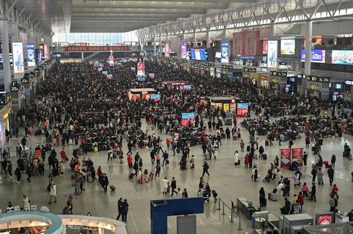 During the annual Lunar New Year holiday, hundreds of millions of Chinese people travel across the country to visit family, including from Hongqiao Railway Station in Shanghai (pictured) (AFP Photo/HECTOR RETAMAL)