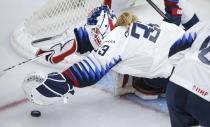 U.S. goalie Alex Cavallini, dives for the puck during the second peirod of an IIHF women's hockey championships game against Switzerland in Calgary, Alberta, Friday, Aug. 20, 2021. (Jeff McIntosh/The Canadian Press via AP)