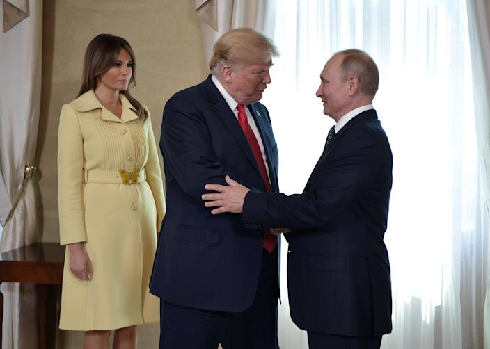 President Vladimir Putin greets President Trump and first lady Melania Trump during a meeting in Helsinki. (Photo: Kremlin/Sputnik/Alexei Nikolsk via Reuters)
