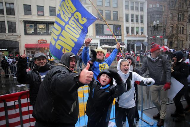 <p>People pose for selfies with Carlos Arredondo as fans line the route during the New England Patriots Super Bowl LI Victory Parade in Boston on Feb. 7, 2017. (Photo by Lane Turner/The Boston Globe via Getty Images) </p>