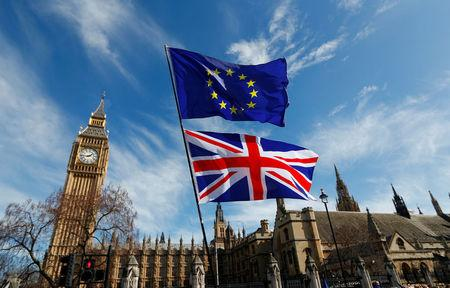 FILE PHOTO: EU and Union flags fly above Parliament Square in London