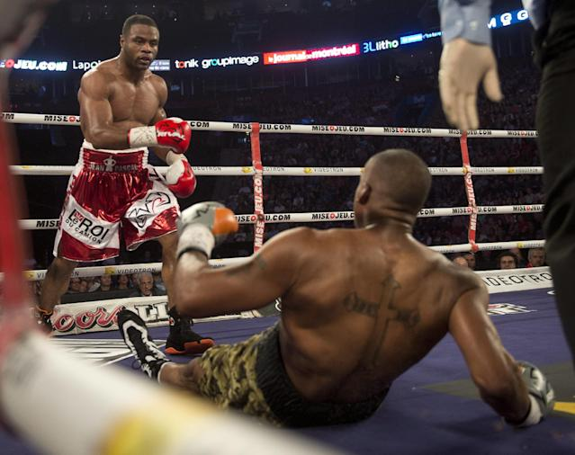 Jean Pascal, from Montreal, knocks down George Blades, from Indiana, during the fifth round of their middleweight fight Saturday, Sept. 28, 2013 in Montreal. Pascal won with a fifth round TKO. (AP Photo/The Canadian Press, Ryan Remiorz)
