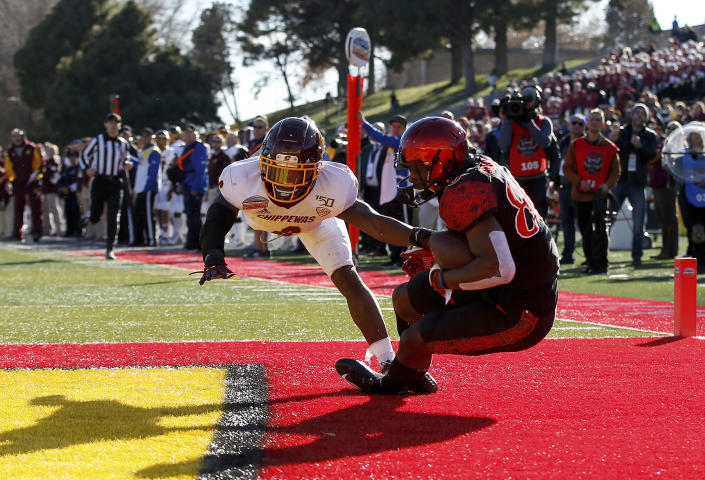 San Diego State wide receiver TJ Sullivan, right, pulls in a touchdown catch as Central Michigan defensive back Da'Quaun Jamison (6) defends during the second half of the New Mexico Bowl NCAA college football game on Saturday, Dec. 21, 2019 in Albuquerque, N.M. (AP Photo/Andres Leighton)