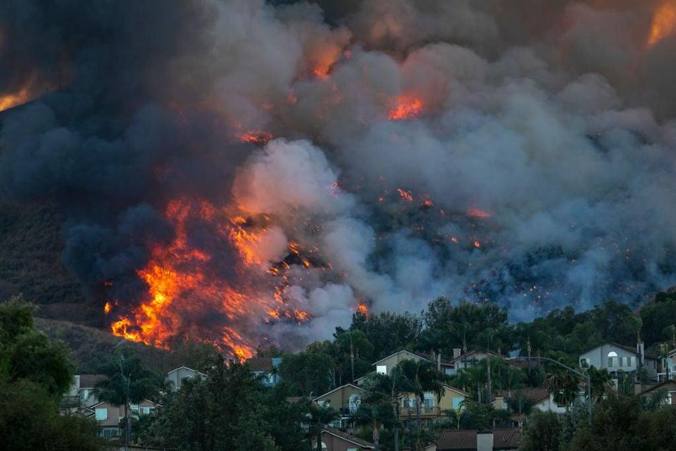 Flames rise near homes during the Blue Ridge Fire on October 27, 2020 in Chino Hills, California (Getty Images)