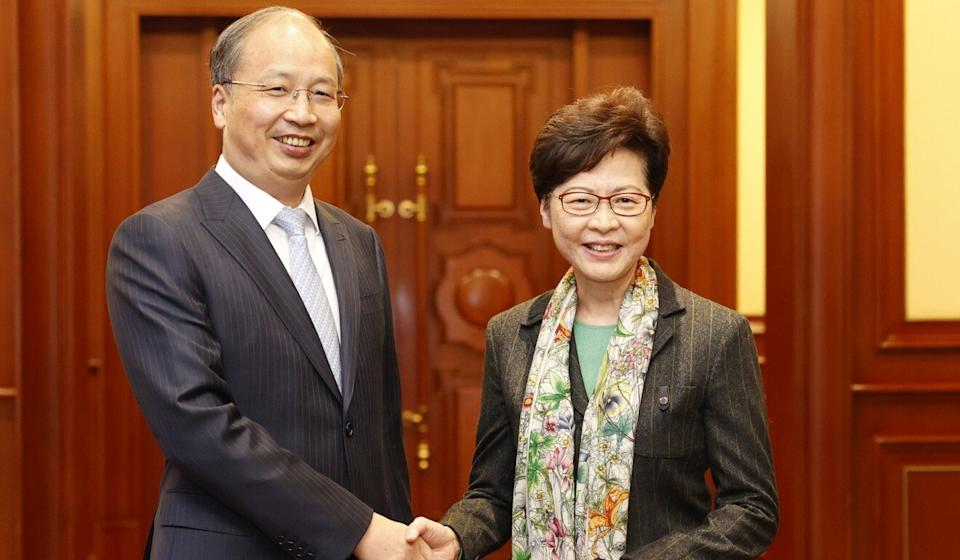 Carrie Lam discussed cross-border finance with the head of China's securities watchdog, Yi Huiman, in Beijing. Photo: Handout