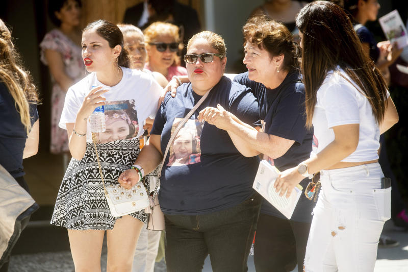 Lorena Pimentel de Salazar, center, leaves a funeral for her daughter Keyla Salazar, 13, on Tuesday, Aug. 6, 2019, in San Jose, Calif. Salazar and two others were killed when a gunman opened fire at the Gilroy Garlic Festival July 28. (AP Photo/Noah Berger)