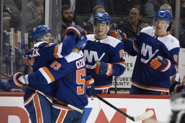 New York Islanders right wing Cal Clutterbuck, left, is congratulated for his goal, by center Casey Cizikas (53) during the second period of the team's NHL hockey game against the Pittsburgh Penguins, Thursday, Nov. 7, 2019, in New York. (AP Photo/Mary Altaffer)