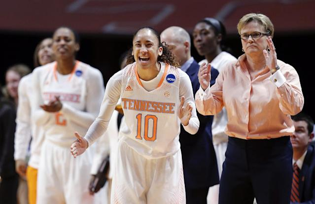 Tennessee guard Meighan Simmons (10) cheers along with head coach Holly Warlick in the first half of an NCAA women's college basketball second-round tournament game against St. John's Monday, March 24, 2014, in Knoxville, Tenn. (AP Photo/John Bazemore)