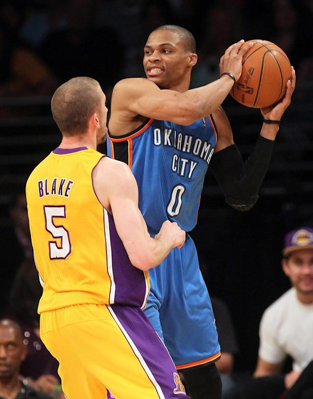 LOS ANGELES, CA - MAY 19: Russell Westbrook #0 of the Oklahoma City Thunder looks to move the ball against Steve Blake #5 of the Los Angeles Lakers in the second quarter in Game Four of the Western Conference Semifinals in the 2012 NBA Playoffs on May 19 at Staples Center in Los Angeles, California. NOTE TO USER: User expressly acknowledges and agrees that, by downloading and or using this photograph, User is consenting to the terms and conditions of the Getty Images License Agreement. (Photo by Stephen Dunn/Getty Images)