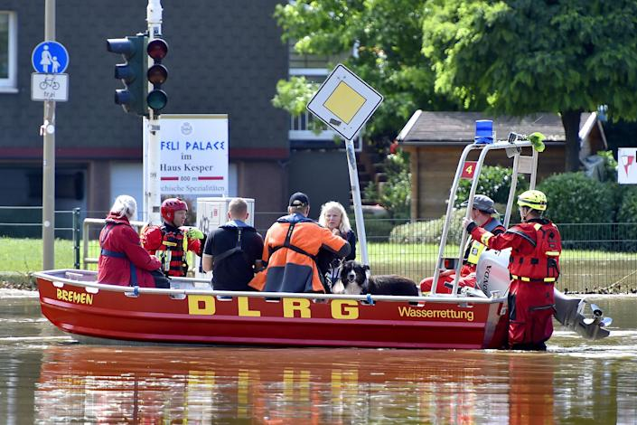 Rescue forces and firefighters evacuate the inhabitants of the In der Lake settlement in Witten, Germany, on Thursday.