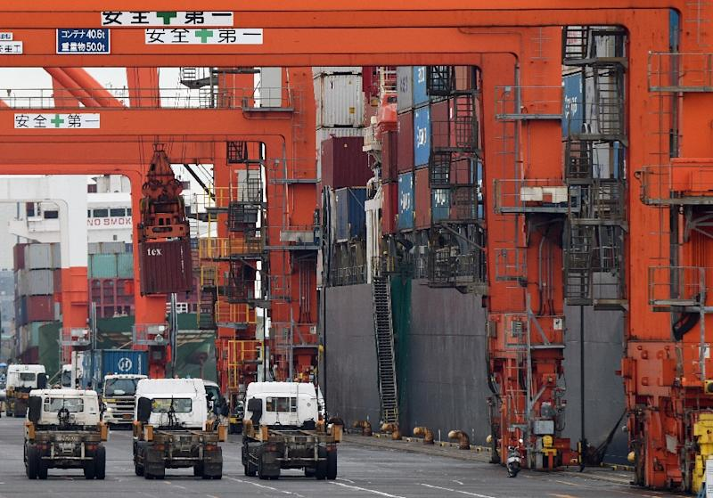 Japan's trade surplus, the first since March, stood at 111.5 billion yen ($902 million) in October, compared with a deficit of 741.76 billion yen in the same month of last year (AFP Photo/Toru Yamanaka)
