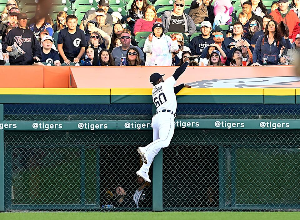 Detroit Tigers outfielder Akil Baddoo (60) steals a home run from Kansas City Royals right fielder Hunter Dozier in the second inning in Detroit, at Comerica Park on Saturday, Sept. 25, 2021.