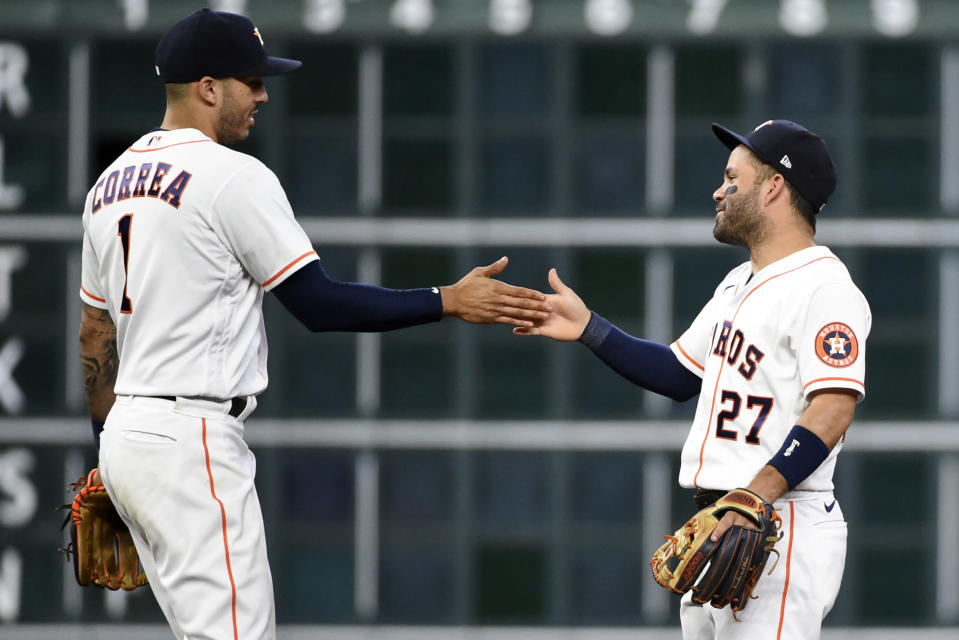 Houston Astros' Carlos Correa, left, and Jose Altuve celebrate the team's win over the Oakland Athletics in a baseball game Wednesday, July 7, 2021, in Houston. (AP Photo/Eric Christian Smith)