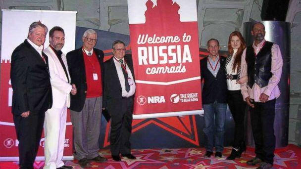 PHOTO: In a December 2015 Facebook post, a Russian gun-rights enthusiast praised 'the American approach to regulating weapons' and shared a photo showing high-ranking NRA members posing alongside Alexander Torshin, 4th-L, and Maria Butina, 2nd-R. (Facebook / Alexander Kudryashov)