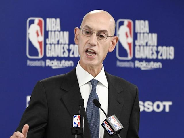 FILE PHOTO: NBA Commissioner Adam Silver speaks during a news conference before the NBA preseason basketball game between Houston Rockets and Toronto Raptors at Saitama Super Arena in Saitama