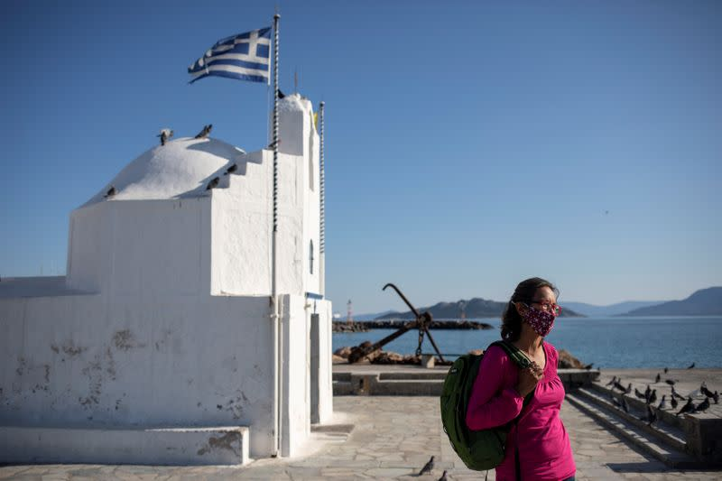 Rowena Harding, 46, stands next to church during an interview with Reuters, on the island of Aegina