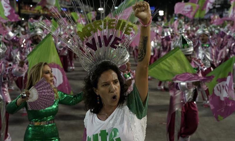 Mônica Benício, widow of Marielle Franco, raises her fist during carnival celebrations in Rio de Janeiro, Brazil on 5 March.