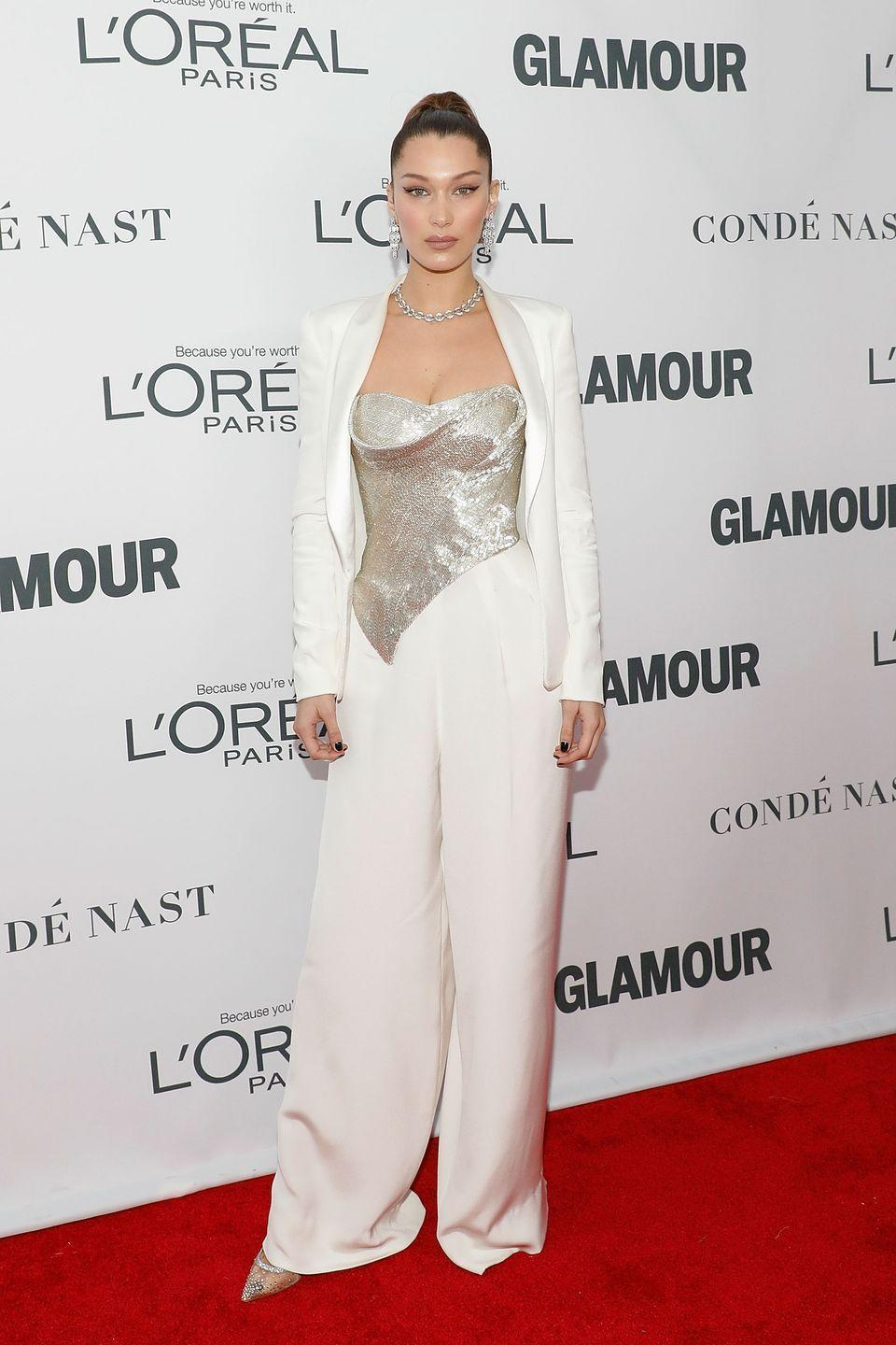 <p>The model wore a white Cristina Ottaviano Spring 2018 suit for the Glamour Magazine Women of the Year Awards in NYC. </p>