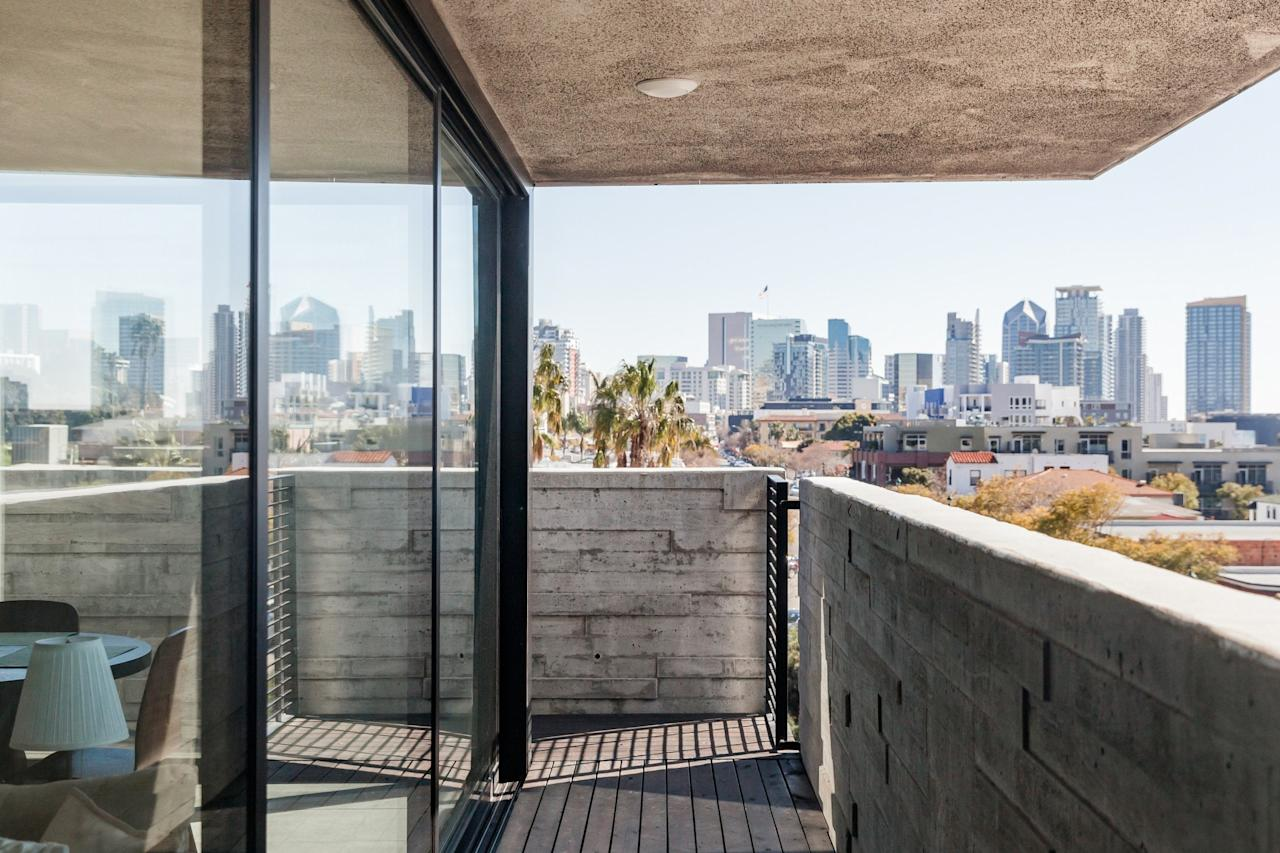"""<p>When you need sand, sun, and a level of calm that you can't get in Los Angeles, <a href=""""https://www.cntraveler.com/destinations/san-diego?mbid=synd_yahoo_rss"""">San Diego</a> is the move. This luxe penthouse overlooking the city's skyline is a great place to relax between taco runs and surf sessions. With two bedrooms and two bathrooms, it's big enough for a family to share, but given the price, it's also inexpensive enough for a couple's weekend. Note, you'll see (and hear) airplanes coming and going, given the proximity to the airport, though most reviewers say the noise is not obtrusive.</p> <p><strong>Book Now:</strong> <a href=""""https://airbnb.pvxt.net/7NjX3"""" rel=""""nofollow"""" target=""""_blank"""">From $130 per night, airbnb.com</a></p>"""
