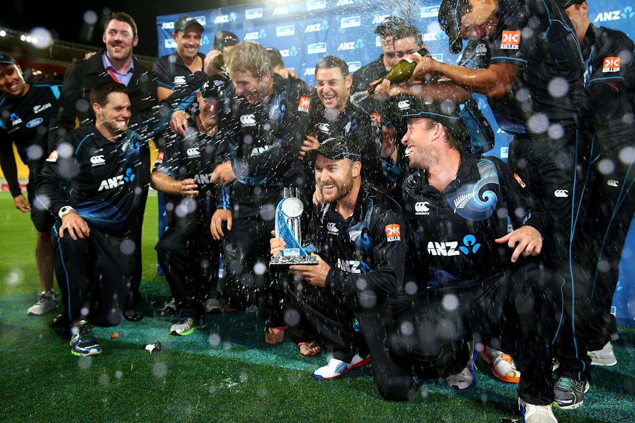 WELLINGTON, NEW ZEALAND - JANUARY 31:  New Zealand celebrate their series win following Game 5 of the men's one day international between New Zealand and India at Westpac Stadium on January 31, 2014 in Wellington, New Zealand.  (Photo by Phil Walter/Getty Images)