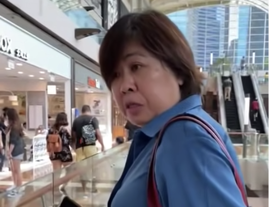 A woman was caught on video for not wearing a mask at Marina Bay Sands on 14 May 2021. (SCREENSHOT: The Independent/YouTube)