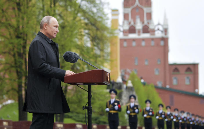Russian President Vladimir Putin addresses the nation from the Tomb of the Unknown Soldier at the Kremlin wall marking the 75th anniversary of the Nazi defeat in World War II in Moscow, Russia, Saturday, May 9, 2020. Putin cancelled a massive Victory Day marking the 75th anniversary of the Nazi defeat in World War II but ordered a flyby of warplanes over Red Square. (Alexei Druzhinin, Sputnik, Kremlin Pool Photo via AP)