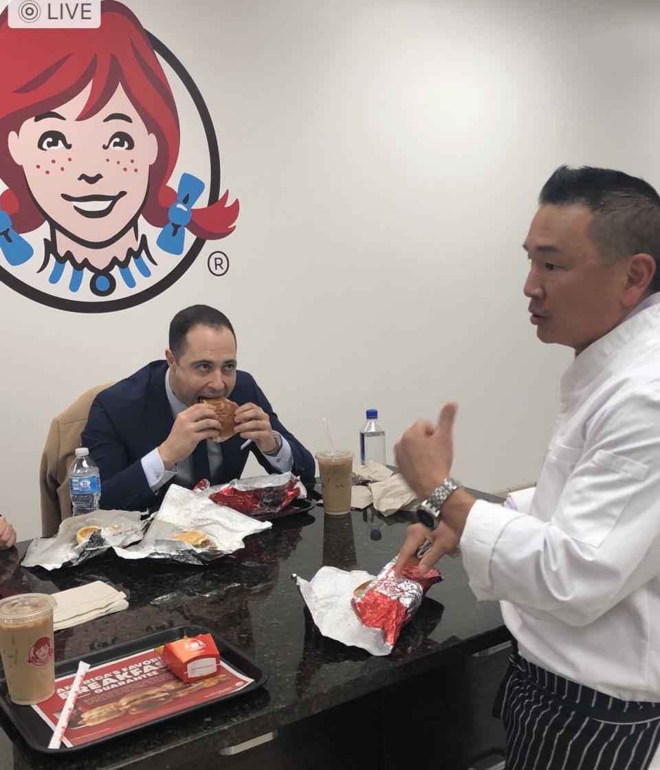 Yours truly samples Wendy's breakfast menu inside the company's headquarters in Columbus, Ohio. Wendy's vice president of culinary innovation (right) John Li explains his inspiration for the menu was brunch.