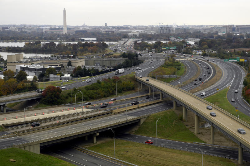 """FILE- This Friday, Nov. 9, 2018, file photo, shows a view of Washington from a revolving restaurant in Crystal City, Va. On Tuesday, Nov. 13, Amazon said it will split its second headquarters between Long Island City in New York and Crystal City. Development along major highways in Northern Virginia and Washington have led to """"unreasonable traffic delays on a daily basis"""" in the past few years, with drive times that used to take 40 minutes ballooning to up to 90 minutes, said Thomas Cooke, professor of business law at Georgetown University's McDonough School of Business. (AP Photo/Susan Walsh, File)"""