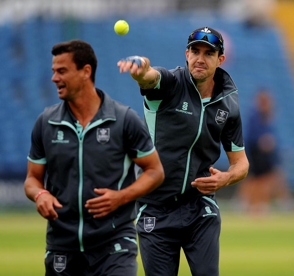 Surrey's Kevin Pietersen (right) playfully throws a tennis ball at Zander De Bruyn (left) during day one of the LV County Championship match at Headingley Cricket Ground, Leeds.