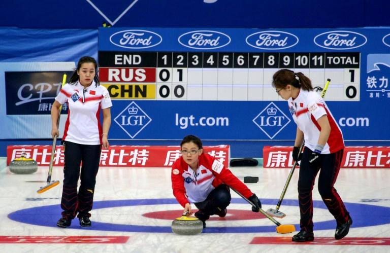 Wang Bingyu (C) has captained China's curling team at historic moments such as a triumph as the 2009 World Championships