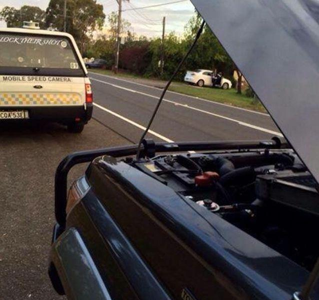 A vehicle picutred blocking the view of a mobile speed camera. Source: Block their shot.
