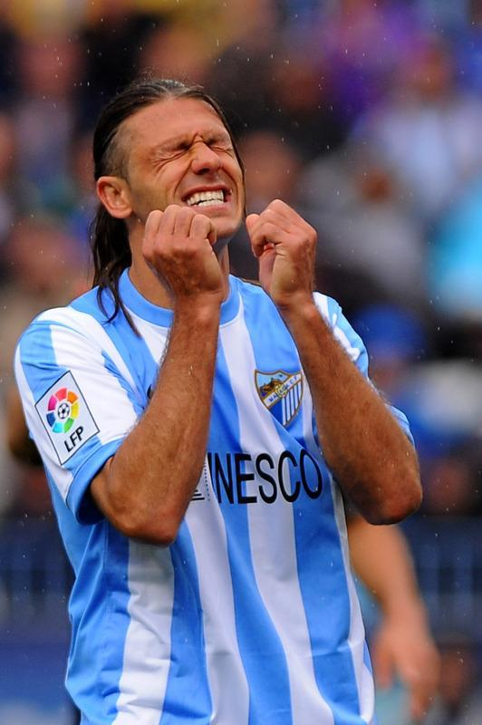 Malaga's Argentinian defender Martin Demichelis reacts during the Spanish league football match between Malaga CF and Valencia CF on April 29, 2012, at the Rosaleda stadium in Malaga. AFP PHOTO/ JORGE GUERREROJorge Guerrero/AFP/GettyImages