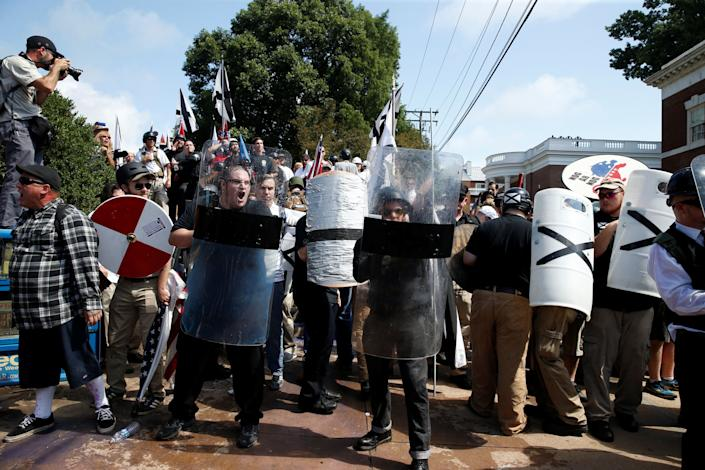 White nationalists and counter-protesters clash.