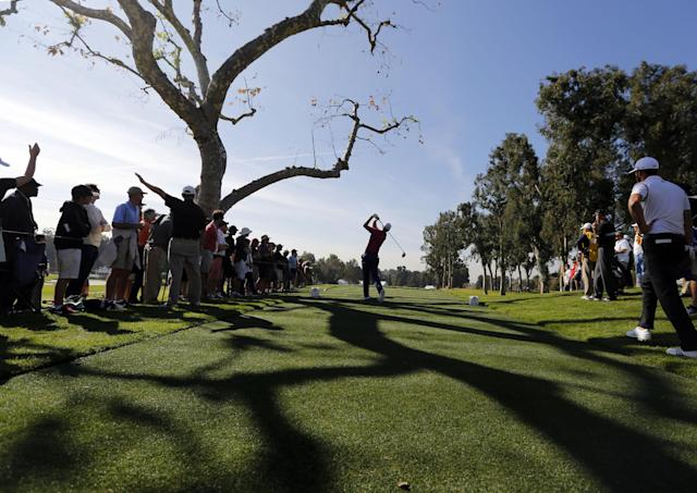 Justin Rose, of England, watches his shot from the third tee in the first round of the Northern Trust Open golf tournament at Riviera Country Club in the Pacific Palisades area of Los Angeles on Thursday, Feb. 13, 2014. (AP Photo/Reed Saxon)