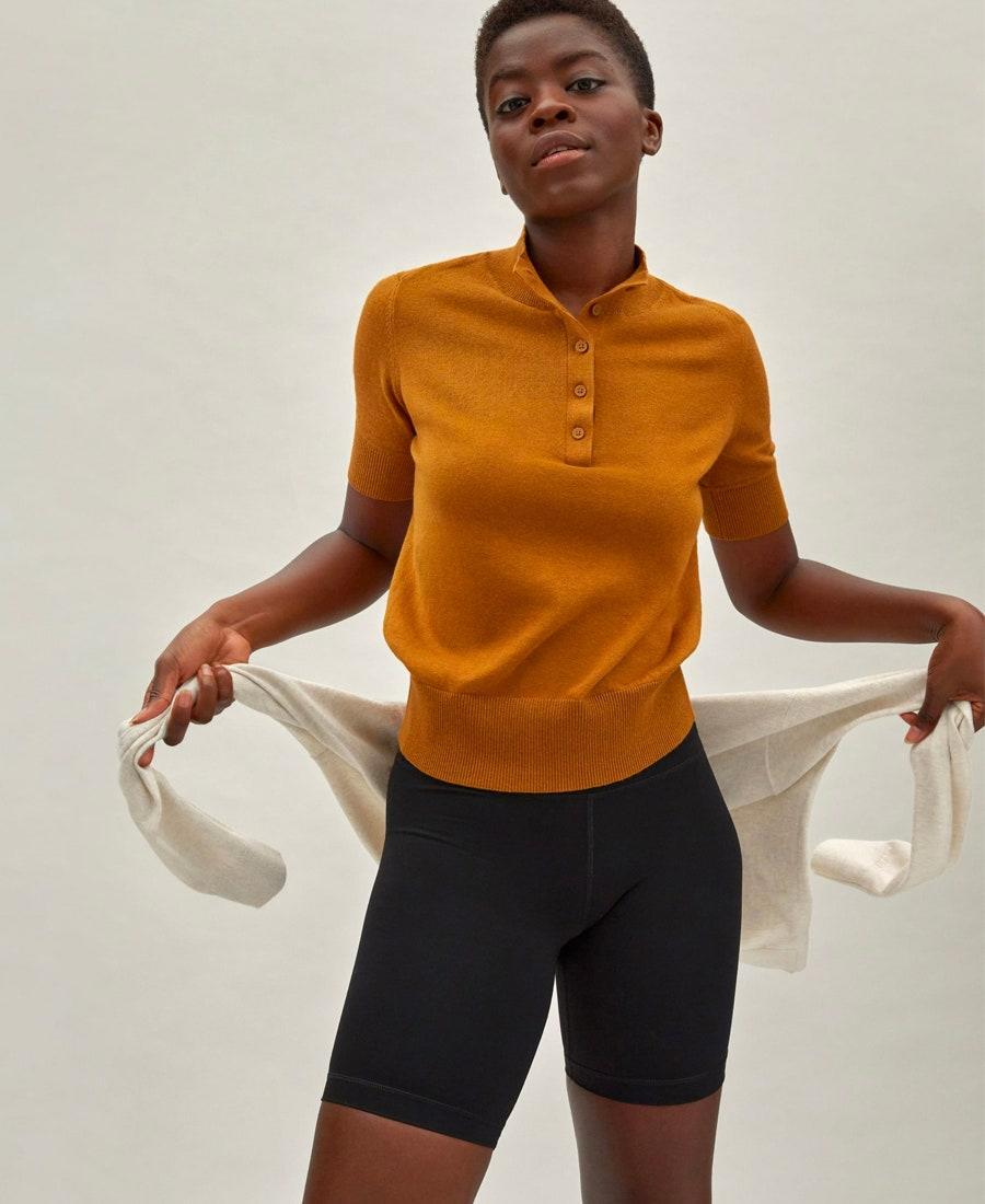 """A warm marigold sweater to wear on a sun-dappled tennis court. You'll be forgiven for not even picking up a racket. $65, Everlane. <a href=""""https://www.everlane.com/products/womens-organic-cotton-button-mockneck-copper?"""" rel=""""nofollow noopener"""" target=""""_blank"""" data-ylk=""""slk:Get it now!"""" class=""""link rapid-noclick-resp"""">Get it now!</a>"""