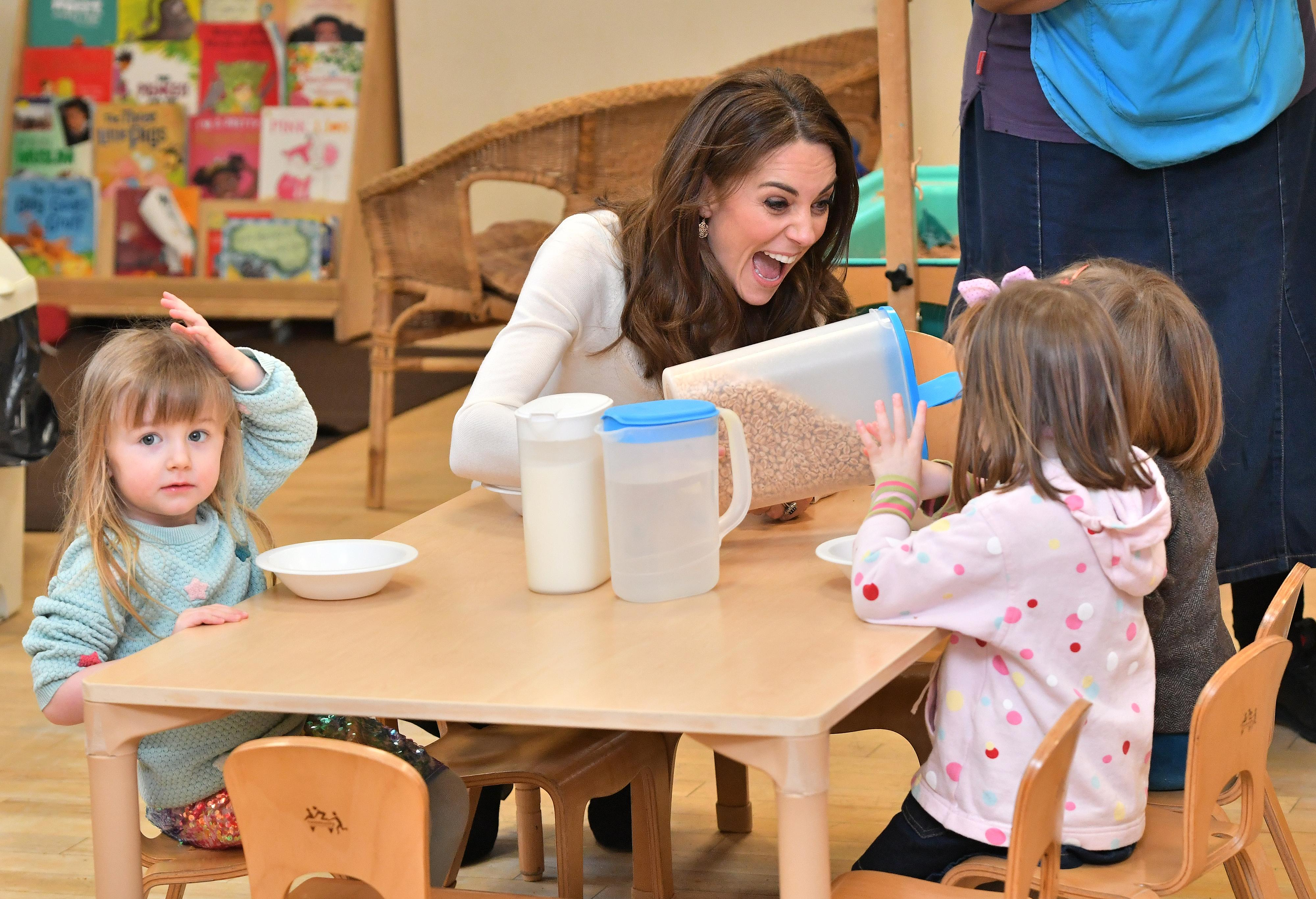 "The Duchess of Cambridge served breakfast to children at LEYF Stockwell Gardens Nursery & Pre-School following last week's launch of the ""5 Big Questions"" survey. [Photo: Getty]"