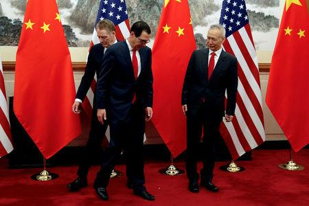 FILE PHOTO: Chinese Vice Premier Liu He looks as U.S. Treasury Secretary Mnuchin swaps places with his Trade Representative Lighthizer during a photograph session in Beijing