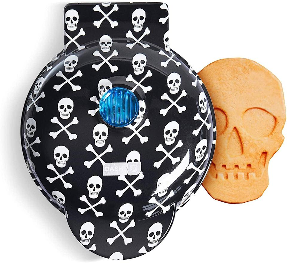 <p>Give their breakfast a spooky twist with this adorable <span>Dash Skull-Shaped Mini Waffle Maker</span> ($20). They can make more than waffles with this mini maker, including hash browns!</p>