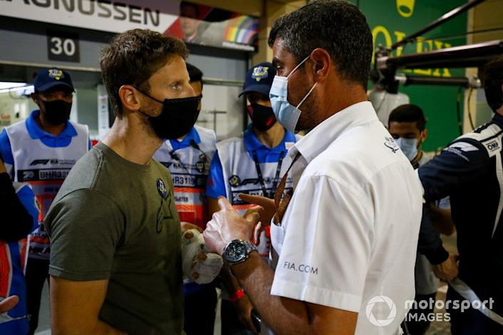 "Romain Grosjean, Haas F1 meets Michael Masi, Race Director <span class=""copyright"">Andy Hone / Motorsport Images</span>"