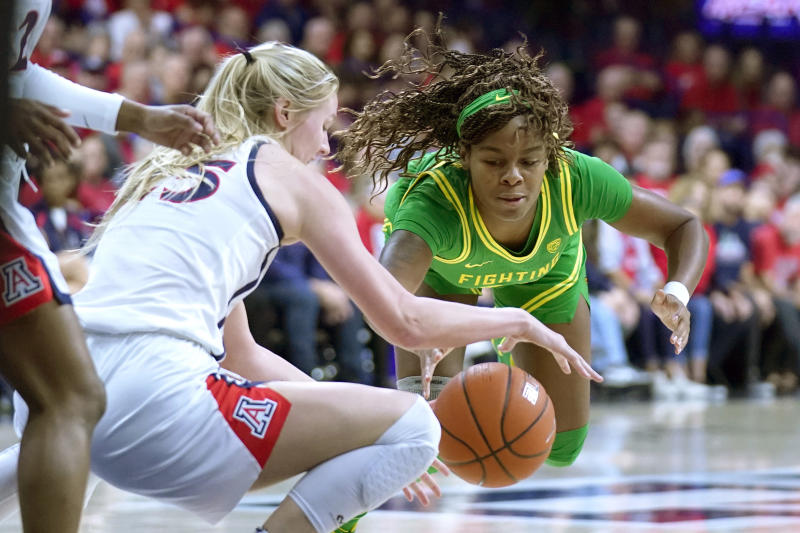Oregon forward Ruthy Hebard, right, and Arizona forward Cate Reese (25) battle for the ball during the first half of an NCAA college basketball game Sunday, Jan. 12, 2020, in Tucson, Ariz. (AP Photo/Rick Scuteri)