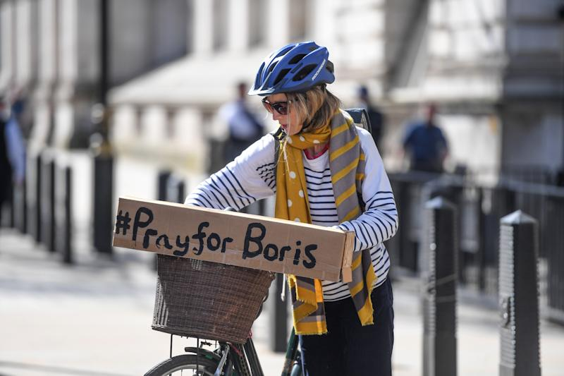 LONDON, ENGLAND - APRIL 07: A cyclist with a sign reading '#PrayforBoris' rides through Westminster on April 7, 2020 in London, England. Prime Minister Boris Johnson was transferred to the intensive care unit at St Thomas' Hospital after his coronavirus symptoms worsened last night. (Photo by Peter Summers/Getty Images)