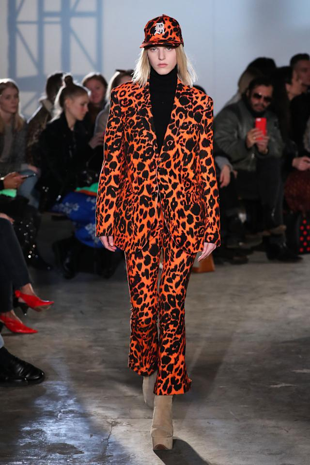 <p>Model wears a an orange leopard pantsuit with Ugg platform heels at the R13 Fall 2018 show. (Photo: Getty) </p>