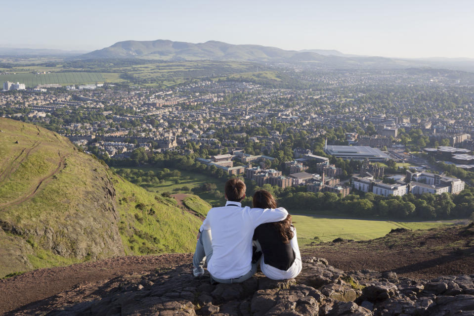 A couple enjoying the phenomenal view from Arthur's Seat (Getty Images)