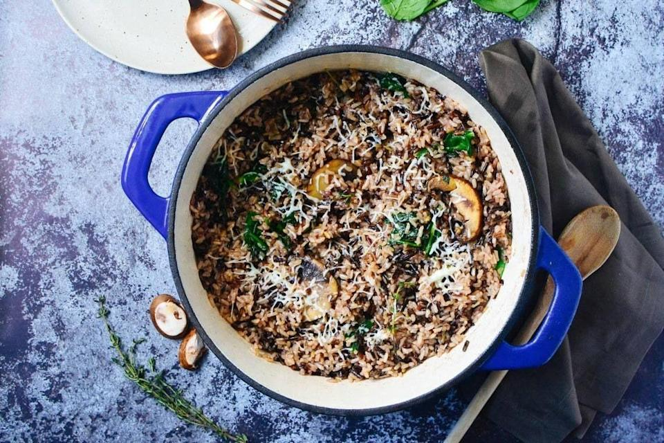 "<p>This rich and hearty one-pot meal is chock full of chicken, spinach, mushrooms, and rice. Perfect for a chilly winter night.</p><p><strong>Get the recipe at <a href=""https://cookswithsoul.com/chicken-and-wild-rice-with-mushroom-casserole/"" rel=""nofollow noopener"" target=""_blank"" data-ylk=""slk:Cooks with Soul"" class=""link rapid-noclick-resp"">Cooks with Soul</a>. </strong><br></p><p><strong><a class=""link rapid-noclick-resp"" href=""https://www.amazon.com/Lodge-EC6D32-Enameled-Dutch-Oven/dp/B07VYFZX6G?tag=syn-yahoo-20&ascsubtag=%5Bartid%7C10050.g.34100795%5Bsrc%7Cyahoo-us"" rel=""nofollow noopener"" target=""_blank"" data-ylk=""slk:SHOP DUTCH OVENS"">SHOP DUTCH OVENS</a><br></strong></p>"