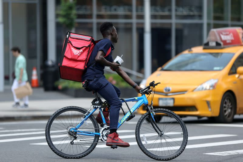 FILE PHOTO: Delivery man cycles in New York