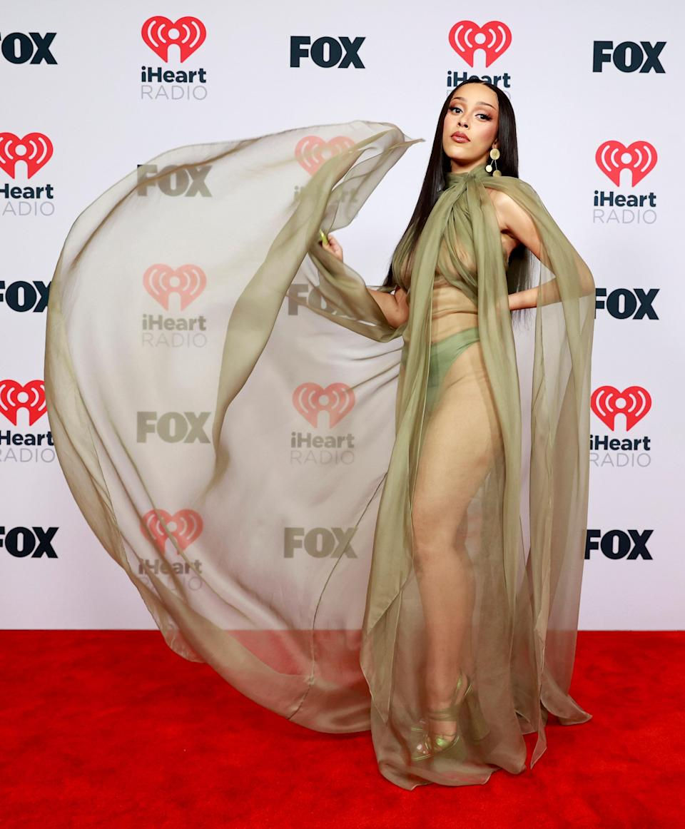 Doja won Best New Pop Artist and stole the show with her numerous wardrobe changes. Styled Brett Alan Nelson, she showed up to the red carpet in a sheer Brandon Maxwell dress. Her khaki chiffon look was a whole moment!
