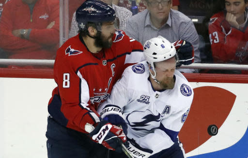 Washington Capitals left wing Alex Ovechkin (8), from Russia, collides with Tampa Bay Lightning defenseman Anton Stralman (6), from Sweden, during the third period of Game 6 of the NHL Eastern Conference finals hockey playoff series, Monday, May 21, 2018, in Washington. The Capitals won 3-0. (AP Photo/Alex Brandon)
